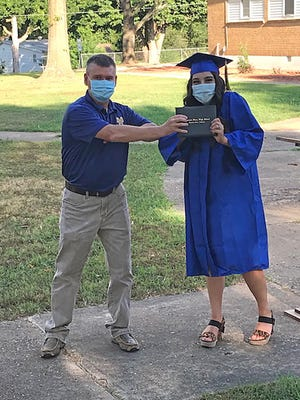 Crystal Mortvedt accepts her diploma from Jeff Kincade, Director at Guy Berry College & Career Academy, on July 24. Four other students also completed the requirements for a high school diploma through the Night Flight program: Dayton Tollison Messick, Elizabeth Richardson, Savanah Tollison, and Kaitlyn Young.