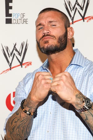 WWE superstars Randy Orton arrive at the Superstars of Hope honors Make A Wish Foundation event at The Beverly Hills Hotel on Thursday, Aug. 15, 2013, in Beverly Hills, Calif.