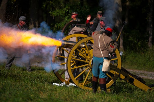 Confederate artillery fires on Union infantry during the 157th Battle of Gettysburg reenactment at the Daniel Lady Farm. The event, created  by the Gettysburg Battlefield Preservation Association, had been postponed from July because of the COVID-19 pandemic.