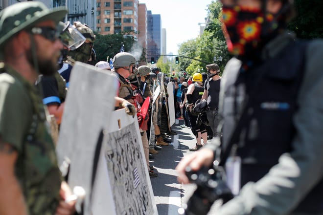 Opposing rallies battle with mace, paintballs and rocks near Justice Center in downtown Portland Saturday.