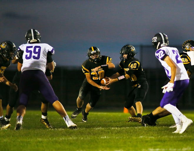 Black River's Dylan Kmitt (40) hands off to Joseph McKean (30) in the high school football game against Keystone on Friday, Oct. 4, 2019.