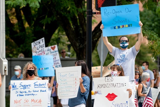 Demonstrators demand in-person instruction during a recent rally in Doylestown Borough. A new group called Bucks Families for Leadership is calling for in-person learning from the Central Bucks School District.