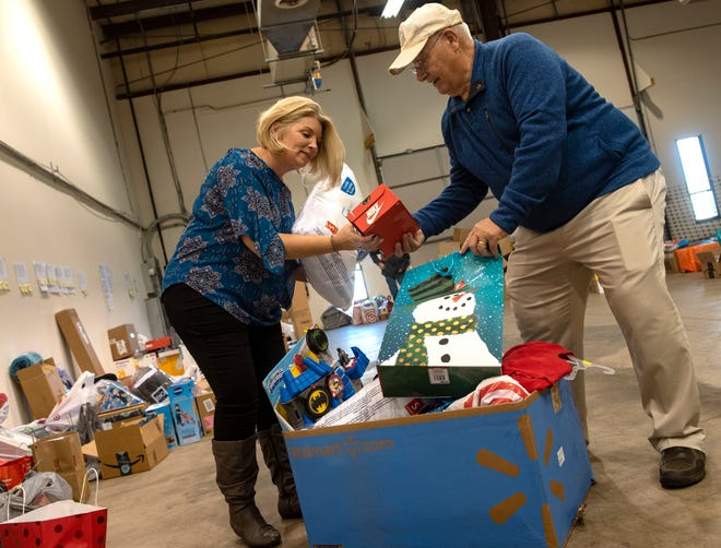 Tara Stoop, founder of Between Friends Outreach, works with volunteers to gather and organize presents for the needy last December. This week the Doylestown nonprofit is challenged to raise $5,000 in 10 days. If it does, the Gene and Marlene Epstein Humanitarian fund will match the donations with a $5,000 grant.