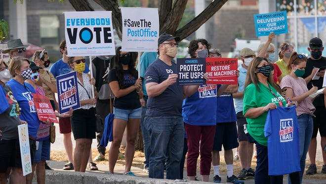 """Protesters gather during a """"Save the Post Office"""" rally in Salt Lake City."""