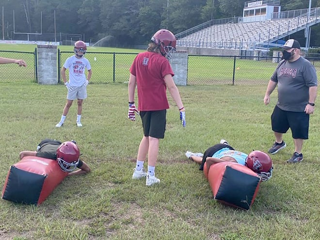Thomas Heyward Academy football players and coaches go through a drill at practice last week.