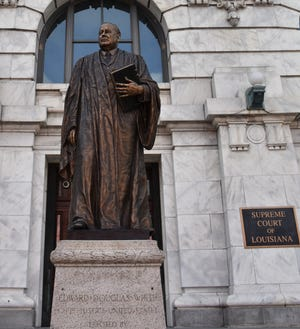 A statue of E.D. White of Thibodaux, who served as a Confederate soldier and a state and U.S. Supreme Court justice, stands in front of the Louisiana Supreme Court building in New Orleans' French Quarter.