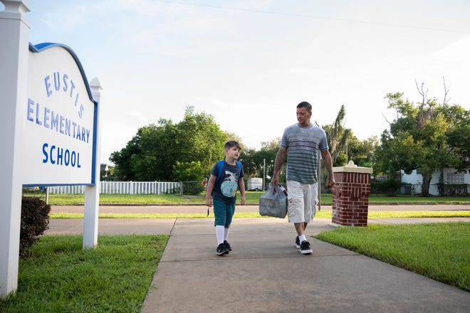 A dad walks his son in to the first day of school at Eustis Elementary School on Monday, Aug. 24. [Cindy Peterson/Correspondent]