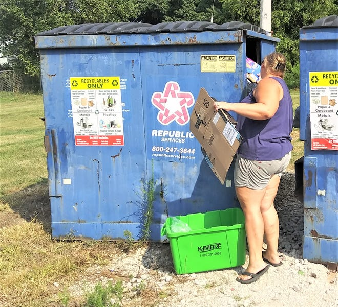 Tab Lint of Clark breaks down some cardboard boxes to recycle at the recycling site in Clark behind the gas station.