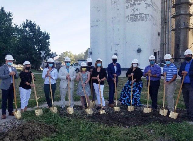 Dallas Center Library, City Staff, City Council, Estes Construction and Pelds Engineering and Architecture representatives help break ground on phase two of the Roy R Estle Memorial Library renovation project.