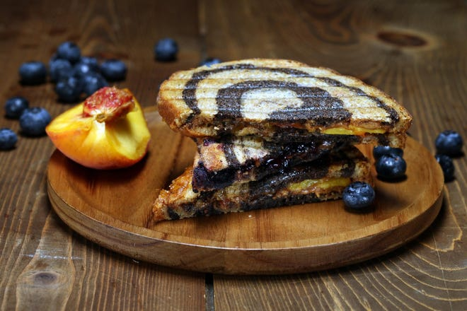 Peanut butter and jelly panini with fresh peach and berries are seen in the Chicago Tribune test kitchen on Thursday, Aug. 6, 2020.