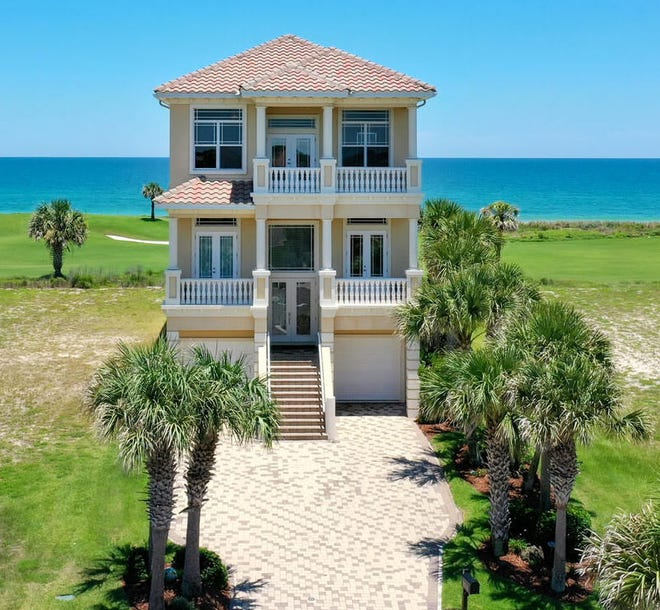 This beachfront house on Hammock Beach Court in Ocean Hammock was built in 2009 on a golf course and sold recently for $1,499,000. It has four bedrooms and four baths in 4,327 square feet of living space. It also has an elevator, a pool and spa, an outdoor fireplace, two balconies and a patio facing the beach, and a master bedroom with a balcony, fireplace and wet bar. Photo provided by Trademark Realty Group
