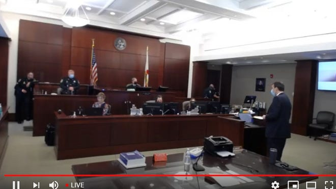 """The first jury trial held entirely """"in-person"""" in the state began on Monday at the Kim C. Hammond Justice Center in Bunnell.  This is a screen grab of a livestream of the trial on YouTube."""