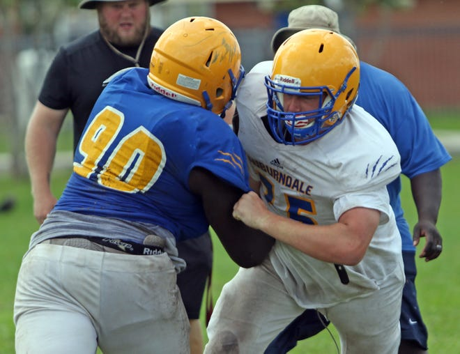 Auburndale offensive and defensive linemen go through drills during practice last year. A decision has yet to be made as to whether or not Polk athletes will be required to sign a COVID-19 waiver.