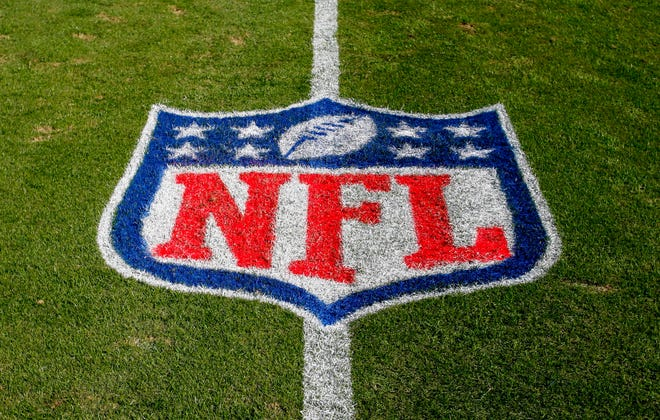 NFL logo is displayed on the field at the Bank of American Stadium