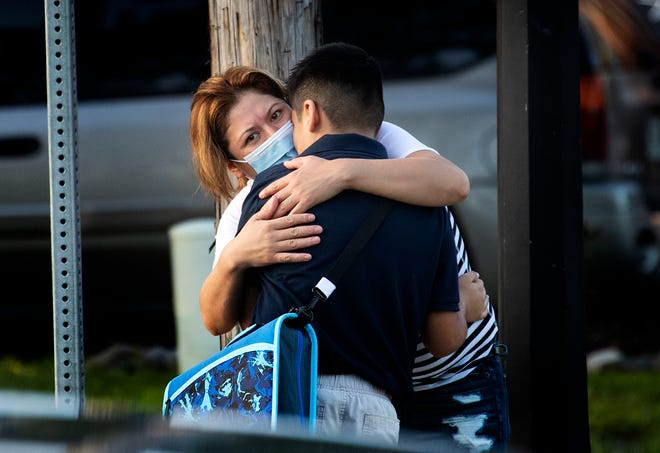 Eva Caballero hugs her son, Axel, goodbye on the first day of school at Dixieland Elementary in Lakeland on Monday.