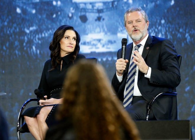Rev. Jerry Falwell Jr., right, with his wife, Becki, speaks during a November 2018 town hall at a convocation at Liberty University in Lynchburg, Va. Falwell resigned Monday from his leadership post at evangelical Liberty University.