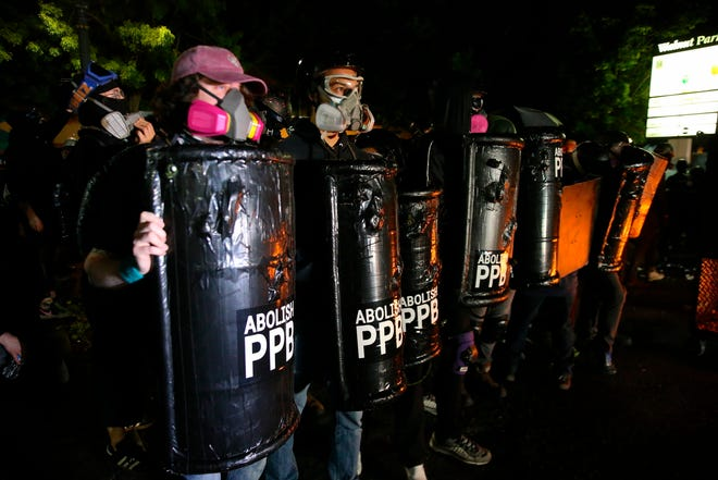 Portland protests continued as a group of several hundred gather outside the Portland Police Bureau: North Precinct on Sunday.