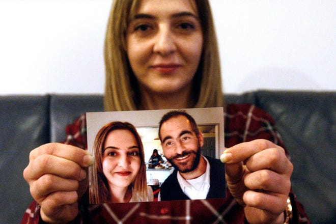 Aya Al-Umari, whose brother Hussein was killed in the Christchurch mosque attacks, holds a photo of herself and her brother, in Christchurch, New Zealand, in July 2019. Al-Umari is one of more than 60 survivors and family members who this week in court will confront the white supremacist who committed the worst atrocity in New Zealand's modern history, when he slaughtered 51 worshippers at two Christchurch mosques in March 2019. The four-day sentencing started Monday.