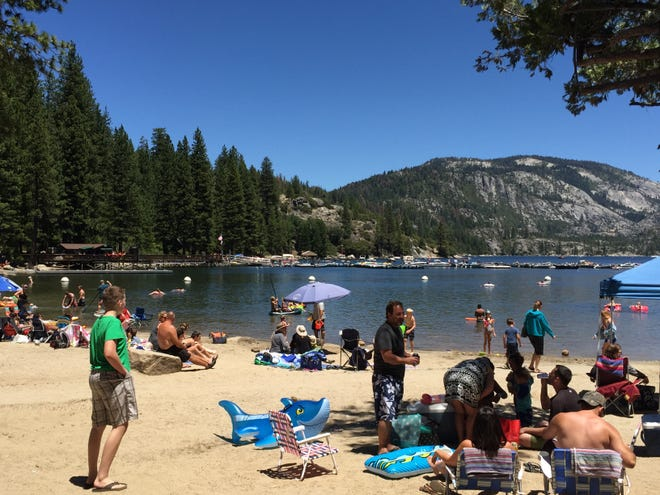 Pinecrest Lake's clear blue waters attract crowds of beach-goers in summer months.