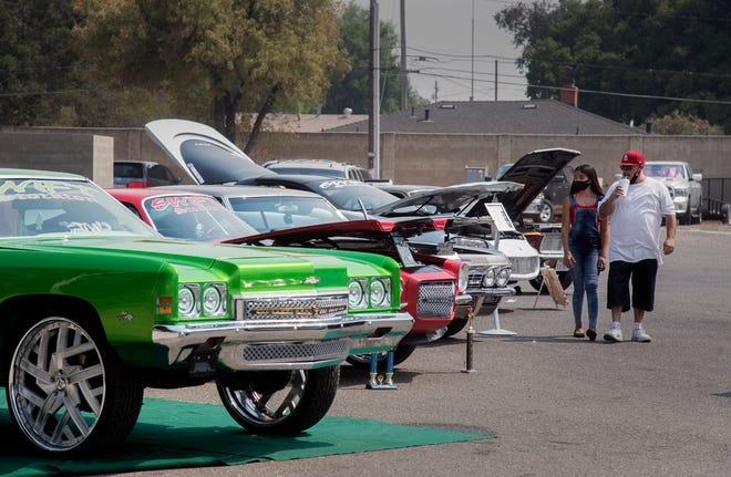 Hundreds of custom cars were on display at the Stockton Lowrider Car Swap Meet 2020 at the San Joaquin County Fairgrounds in Stockton. Hosted by Impalas Magazine, attendees were encourage to wear facemarks, social distance themselves and use the hand sanitizer station placed at the event. [CLIFFORD OTO/THE STOCKTON RECORD]