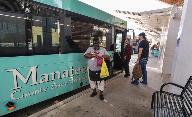 Travelers board and depart buses at the Manatee County Area Transit bus station in downtown Bradenton in 2019.