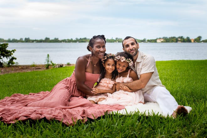 "Errika Walker-Magra, with her husband Placido Magra and their two daughters, Siloam, 11 (right) and Shadai, 10. Walker-Magra says her mixed-race family is subject to frequent ""micro-aggressions."""
