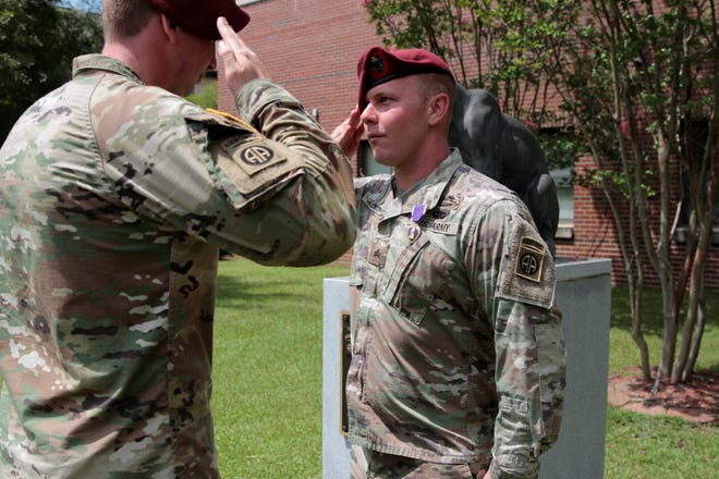 Sgt. David Scudder, a paratrooper with the 3rd Brigade Combat Team, 82nd Airborne Division, receives his Purple Heart from his battalion leadership Friday, Aug. 21, 2020.