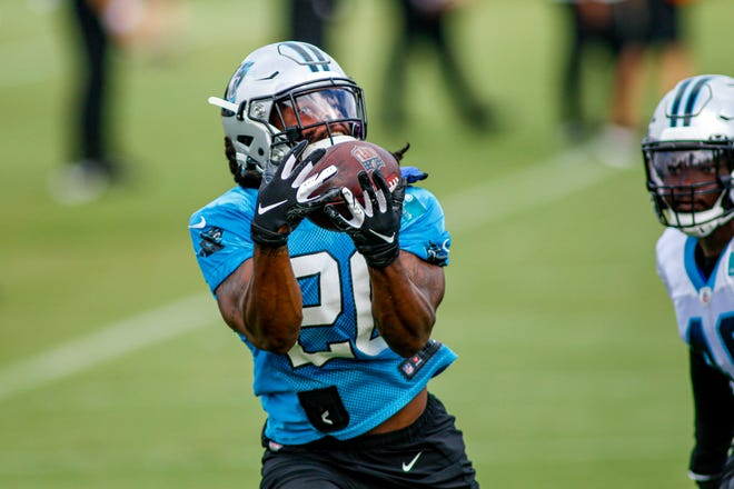 Carolina running back Jordan Scarlett pulls in a catch during the training camp practice Aug. 16 in Charlotte, N.C. The Panthers waived Scarlett on Sunday.