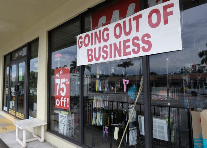 "A store with a ""Going out of Business"" sign is shown in North Miami Beach. [AP Photo/Wilfredo Lee, File]"