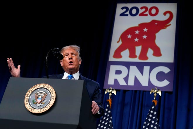 President Donald Trump speaks on stage during the first day of the Republican National Committee Convention on Monday, Aug. 24, 2020, in Charlotte.