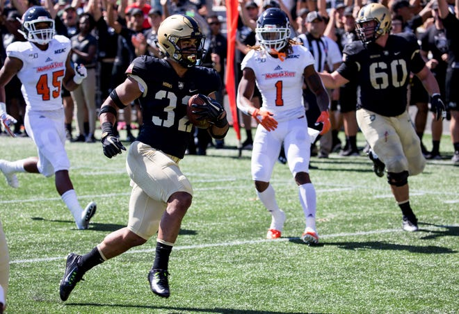 Running back Artice Hobbs (32) and Army will play a record eight home games in amended 2020 schedule including BYU on Sept. 19 and Air Force on Nov. 7. JULIUS CONSTANTINE MOTAL/AP