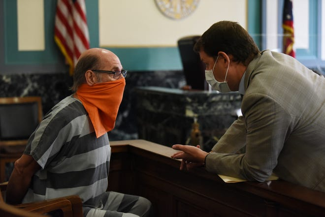 """Gene Jackson, at left, before his arraignment in Hamilton County Common Pleas Court on Monday, August 24, 2020. Jackson is charged with sexually assaulting four women who went to his Blue Ash business, """"The Crystal Guy,"""" for healing sessions or massages. The alleged sexual assaults happened in 2005, 2013, 2017 and 2018, according to court documents."""