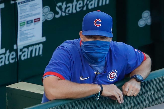 Chicago Cubs manager David Ross looks on from dugout during the fourth inning of a game on Aug. 19, 2020  against the St. Louis Cardinals at Wrigley Field.