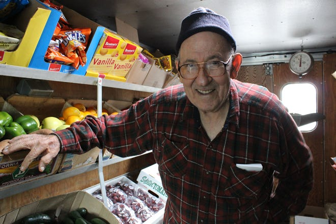 Charlie Cracchiolo, 81, from Eastpointe, stands inside his fruit and vegteable truck outside Comerica Bank in downtown Detroit Wednesday, September 28, 2011.