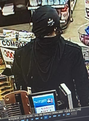 Police are asking help in finding a man involved in an armed robbery at a Speedway in Fox Crossing.