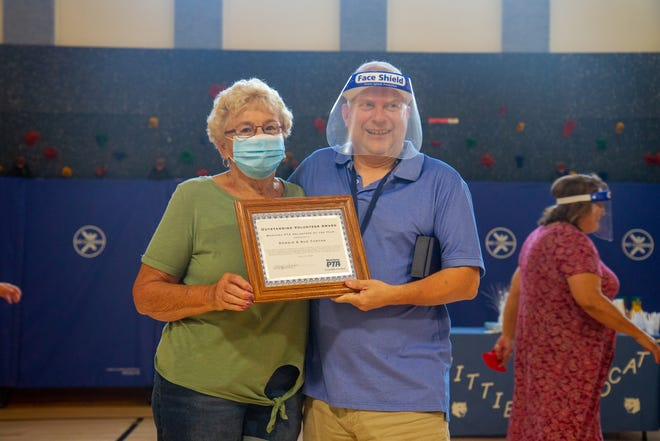 Sue Turton stands with Dean Jardee, a specialist at Whittier Elementary and PTA president. Sue and Dennis Turton were recognized as recipients of the 2020 Outstanding Volunteer Award through the Montana PTA Association.