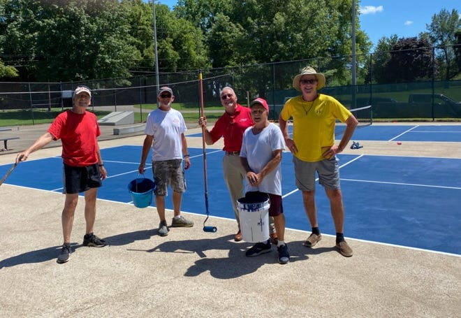 Volunteers refurbished the pickleball courts at Henderson's Community Park.