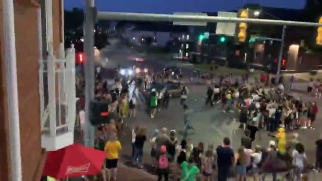 This video still shows a car driving through a protest organized by the Iowa Freedom Riders Aug. 21, 2020, in Iowa City.