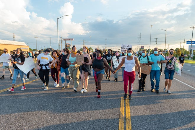 Protesters march down Ambassador Caffery and Johnston Street  Sunday, Aug. 23, 2020.