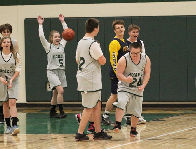 Howell celebrates a basket in a unified basketball game against Hartland.