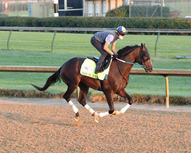 Max Player and jockey Florent Geroux breeze Monday morning at Churchill Downs.
