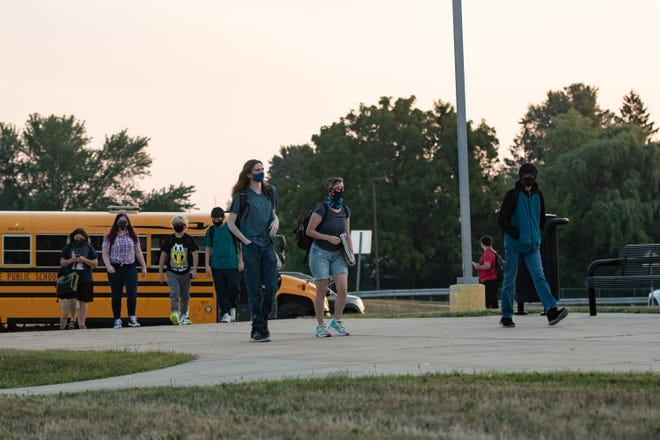 Students arrive for the first day of in-person classes Monday, Aug. 24, 2020, at Charlotte High School in Charlotte.