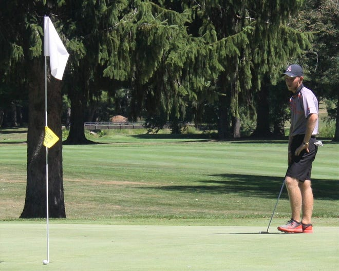 Ashland's Tyler Sabo could use a strong gust of wind to blow his putt into the hole during last week's Weiss Invitational at Ashland Golf Club.