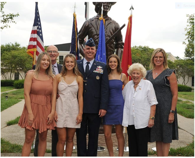 Newly promoted Brig. Gen. Gary McCue, director of the joint staff for the Ohio National Guard, stands for a photo with his family following his promotion ceremony Aug. 7 at the Maj. Gen. Robert S. Beightler Armory in Columbus. From left are daughter Emily McCue, father-in-law Rod McElfresh, daughter Carly McCue, Brig. Gen. McCue, daughter Zoe McCue, mother Rosemary McCue and wife Molly McCue.