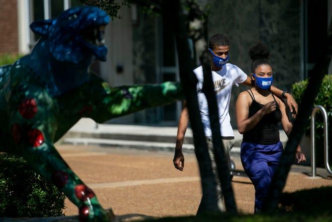Freshman Geordon Spragin, 18, of Tupelo, Miss., and Lamiya Stiger, 18, of Milan, walk near the Tiger Den on Monday, Aug. 24, 2020, on the University of Memphis campus.