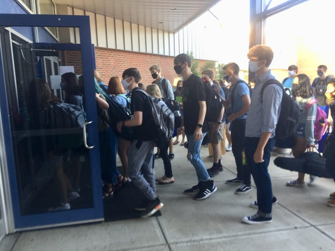 Granville High School students, all masked, began filtering into the building for their first day of in-person school since early this year on Aug. 24.