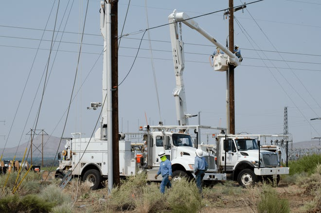 El Paso Electric crews on Monday, Aug. 24, 2020, fix power lines and poles damaged in a storm the night before. A power outage impacted thousands of customers in Las Cruces and Doña Ana.
