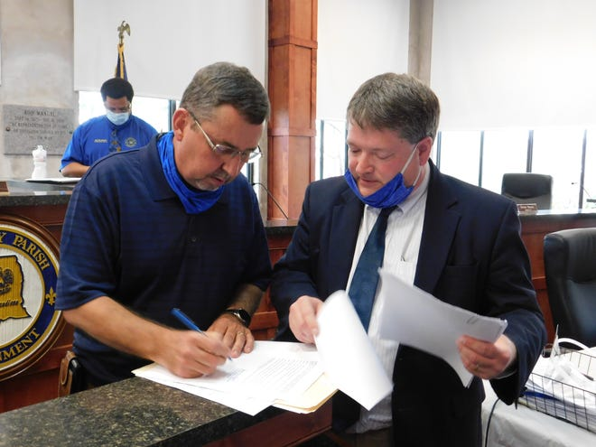 Interim St. Landry Parish President Jessie Bellard signs the necessary paperwork to send to the Office of Secretary of State on Monday after he was appointed interim president. Bellard recently dismissed parish public works director Russell Schexnayder and parish airport director David Allen.