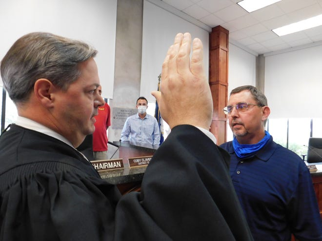 State District Judge Jason Meche administers the oath of interim parish president to Jessie Bellard Monday afternoon.
