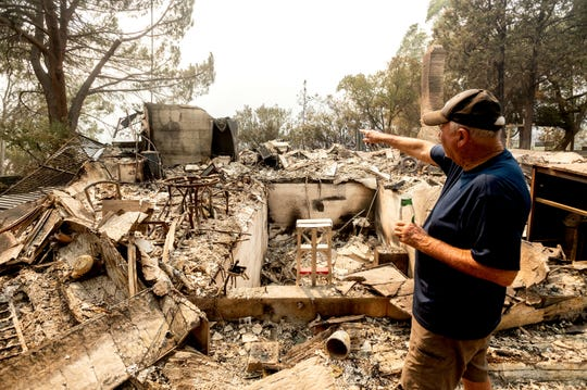 Hank Hanson, 81, gestures to the kitchen of his home, destroyed by the LNU Lightning Complex fires, in Vacaville on Friday, Aug. 21, 2020. Hanson, who built the house thirty years ago, does not think he will rebuild.